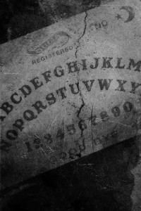The Ouija board from Dinner with the Cannibal Sisters by Douglas Clegg, image by Caniglia.